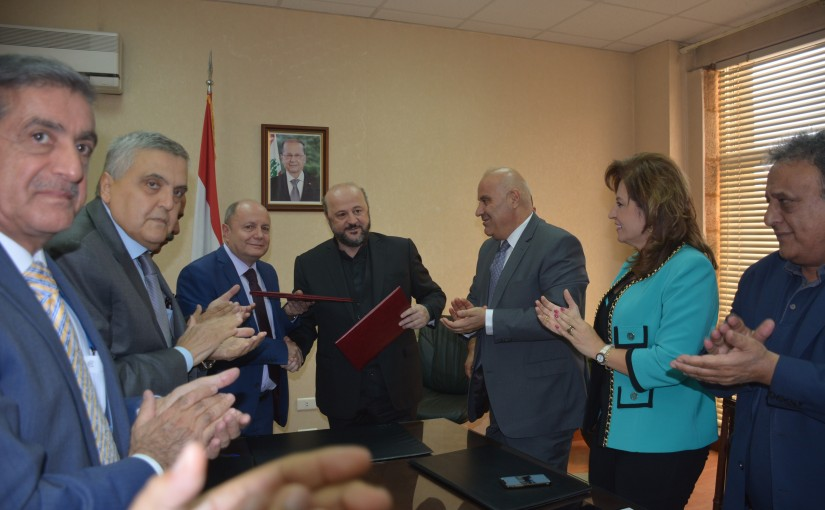 Signing Agreements Between Minister Melhem Riachi and Bechara Asmar