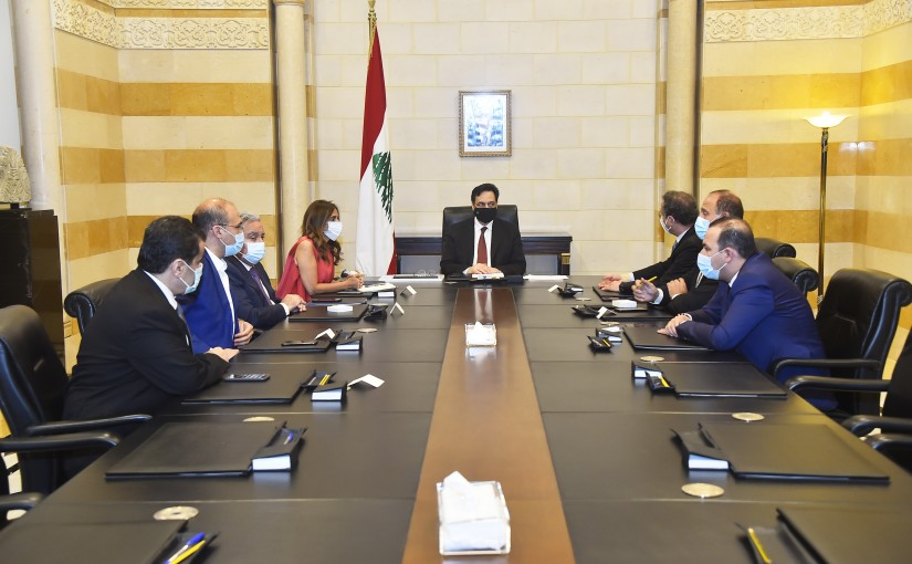 Minister Hassan Hamad Heading a Financial Crisis Meeting